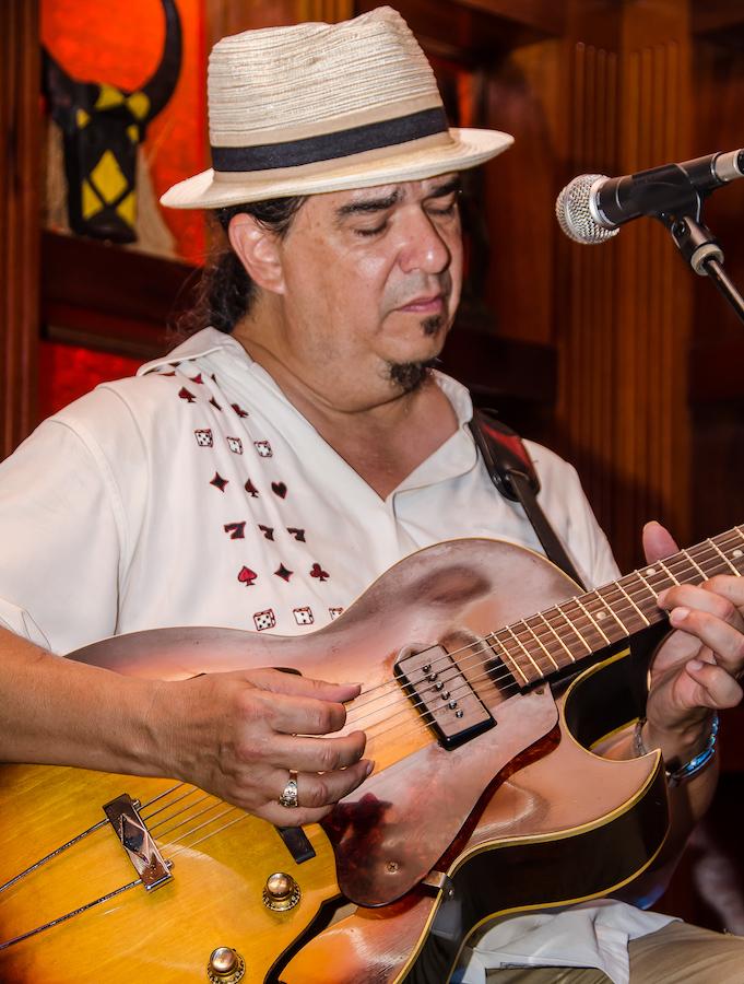 Larry playing guitar